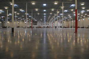 This warehouse floor is reinforced with 1-inch, Type II steel fibers at 70 pcy. Just walking around on it, you would be hard pressed to spot a fiber.